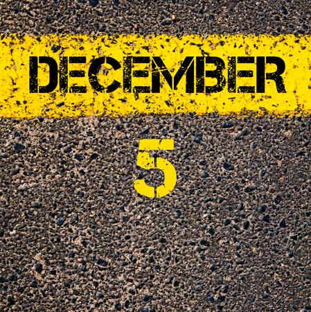 5 december: 5 December calendar day written over road marking yellow paint line