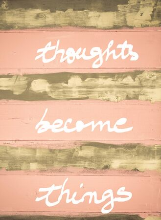 become: Concept image of Thoughts become Things motivational quote hand written on vintage painted wooden wall Stock Photo