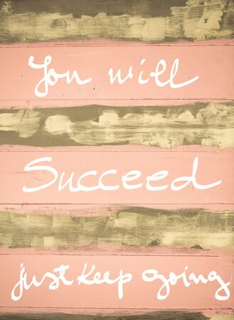 succeed: Concept image of You Will succeed, just keep going motivational quote hand written on vintage painted wooden wall Stock Photo