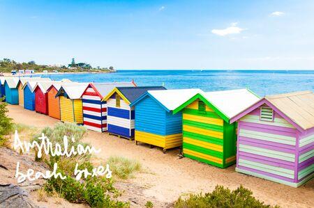 written text: Bathing boxes at Brighton Beach, Australia with hand written text Australian beach boxes Stock Photo