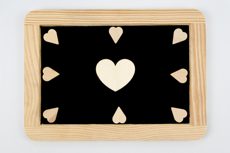 scribe: Vintage Chalkboard with wooden frame isolated on white, craft heart shapes around, one big heart in the middle, creativity and love concept
