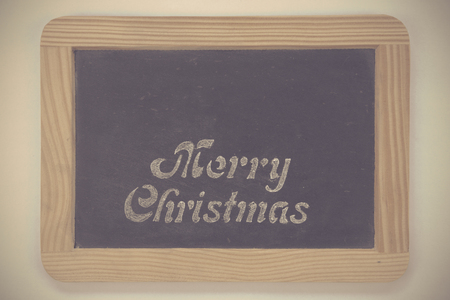 christmas paste: Wooden frame vintage chalkboard with Merry Christmas message, isolated on white, copy space available