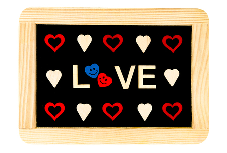 replaced: Wooden frame vintage chalkboard isolated on white with Word LOVE created of wood letters and heart shapes around, letter O replaced by pair of smiling in love emoticons, love conceptual image