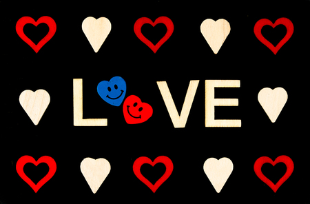 replaced: Vintage chalkboard with Word LOVE created of wood letters and heart shapes around, letter O replaced by pair of smiling in love emoticons, love conceptual image