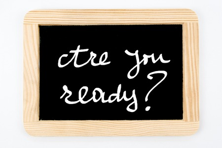 inscribe: Vintage Chalkboard with wooden frame isolated on white, message Are You Ready