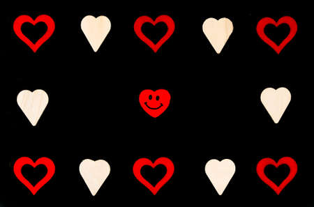 scribe: Heart shapes symbols and smiling emoticon isolated on black, available copy space, love concept Stock Photo