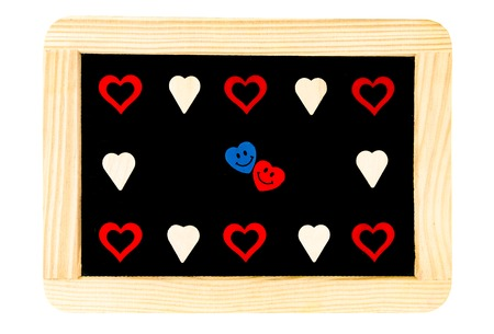 replaced: Wooden frame vintage chalkboard isolated on white with heart shapes around, letter O replaced by pair of smiling in love emoticons, love conceptual image