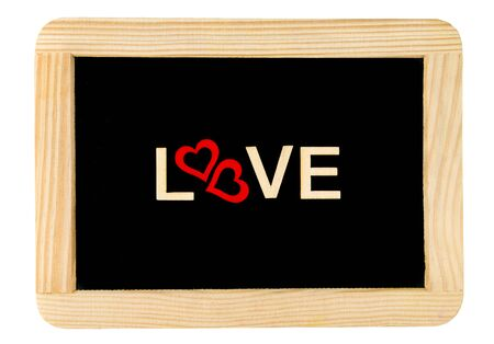 replaced: Wooden frame vintage chalkboard isolated on white with Word LOVE created of wood letters,  letter O replaced by pair of red wooden heart shape, conceptual image