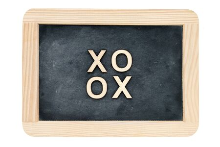 xoxo: Wooden frame vintage chalkboard isolated on white with text XOXO (kisses & hugs) created of wood letters, love concept Stock Photo