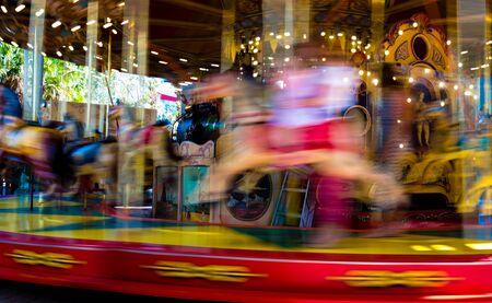 fairground: Blurred defocused background of traditional fairground vintage carousel