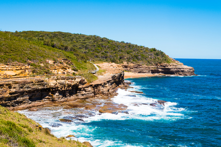 devonian: Australian rock formation with ocean in background, sandstone texture with iron traces in australia, devonian stones Stock Photo