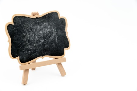 faded: Wooden easel mini blackboard with faded chalk surface, left hand side view, isolated on white, copy space available Stock Photo