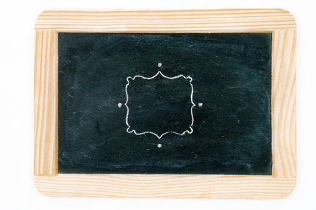copy paste: Wooden vintage chalkboard frame isolated on white with hand drawing chalk border as design resource, copy paste available Stock Photo