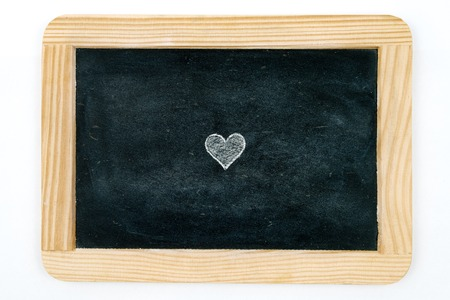 copy paste: Wooden vintage chalkboard frame isolated on white with heart shape symbol filled with white as design resource, copy paste available Stock Photo