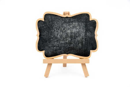 display board: Wooden easel mini blackboard with faded chalk surface, front view, isolated on white, copy space available Stock Photo