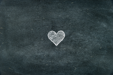 copy paste: Hand drawing heart shape symbol filled with white on blackboard as design resource, copy paste available Stock Photo