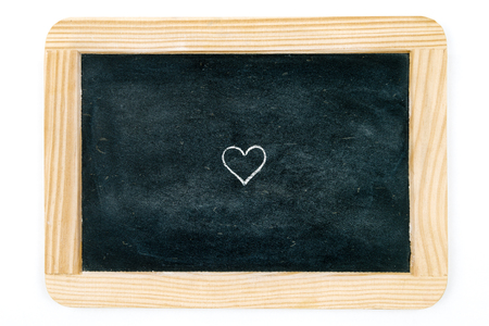 copy paste: Wooden vintage chalkboard frame isolated on white with heart shape symbol as design resource, copy paste available Stock Photo