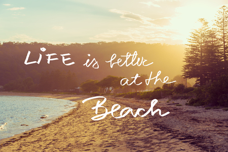 better days: Handwritten text over sunset calm sunny beach background, LIFE IS BETTER AT THE BEACH, vintage filter applied, motivational concept image