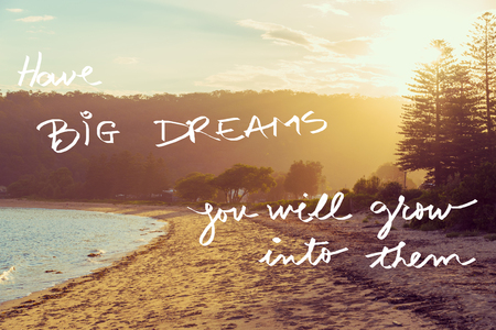 them: Handwritten text over sunset calm sunny beach background, HAVE BIG DREAMS YOU WILL GROW INTO THEM, vintage filter applied, motivational concept image Stock Photo