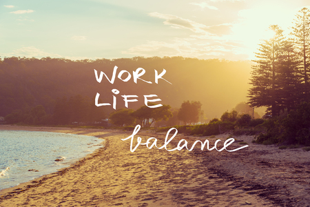 Handwritten text over sunset calm sunny beach background, WORK LIFE BALANCE, vintage filter applied, motivational concept image Stockfoto
