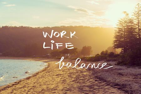 Handwritten text over sunset calm sunny beach background, WORK LIFE BALANCE, vintage filter applied, motivational concept image Foto de archivo