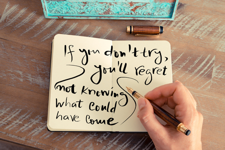 knowing: Retro effect and toned image of a woman hand writing a note with a fountain pen on notebook. Handwritten text IF YOU DONT TRY, YOULL REGRET NOT KNOWING WHAT COULD HAVE COME, business success concept