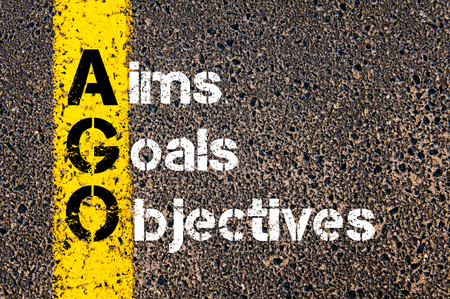 objectives: Concept image of Business Acronym AGO Aims Goals Objectives written over road marking yellow paint line.
