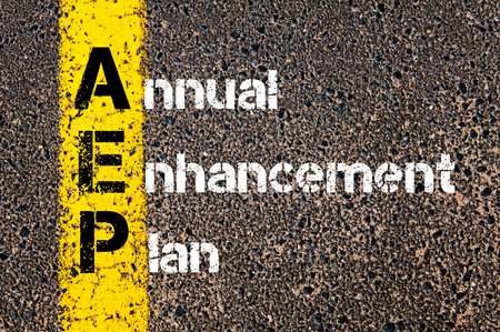 enhancement: Concept image of Business Acronym AEP Annual Enhancement Plan written over road marking yellow paint line. Stock Photo
