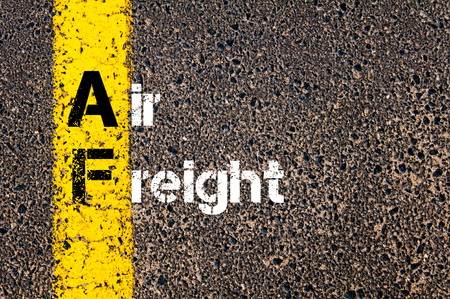 air freight: Concept image of Business Acronym AF Air Freight written over road marking yellow paint line. Stock Photo