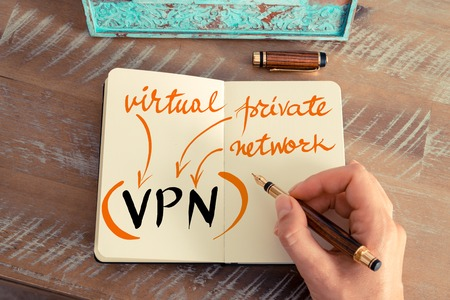 vpn: Retro effect and toned image of a woman hand writing a note with a fountain pen on a notebook. Handwritten Business Acronym VPN VIRTUAL PRIVATE NETWORK, motivation concept