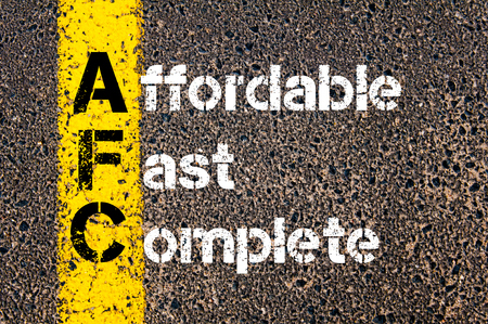 affordable: Concept image of Business Acronym AFC Affordable, Fast, Complete written over road marking yellow paint line. Stock Photo