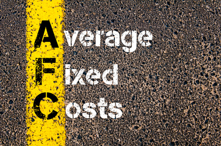fixed: Concept image of Business Acronym AFC Average Fixed Costs written over road marking yellow paint line. Stock Photo