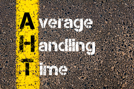 handling: Concept image of Business Acronym AHT Average Handling Time written over road marking yellow paint line. Stock Photo