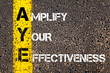 amplify: Concept image of Business Acronym AYE Amplify Your Effectiveness written over road marking yellow paint line