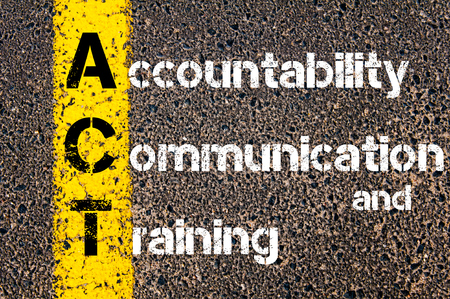 accountability: Concept image of Business Acronym ACT Accountability, Communication, and Training written over road marking yellow paint line.