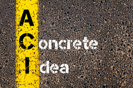 yellow line: Concept image of Business Acronym ACI A CONCRETE IDEA written over road marking yellow paint line. Stock Photo