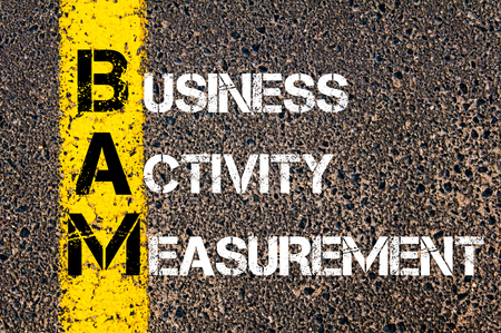 business activity: Concept image of Business Acronym BAM Business Activity Measurement written over road marking yellow paint line