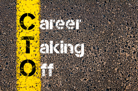 road marking: Concept image of Business Acronym CTO CAREER TAKING OFF written over road marking yellow paint line. Stock Photo
