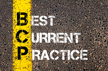 bcp: Concept image of Business Acronym BCP Best Current Practice written over road marking yellow paint line Stock Photo