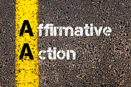 affirmative: Concept image of Business Acronym AA Affirmative Action written over road marking yellow paint line.