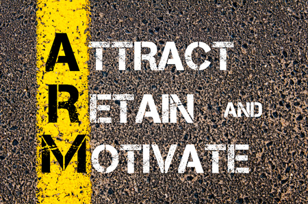 retain: Concept image of Business Acronym ARM Attract, Retain, And Motivate written over road marking yellow paint line Stock Photo