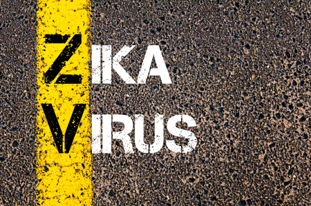 Concept image of Medical Acronym ZV ZIKA VIRUS written over road marking yellow paint line. Reklamní fotografie