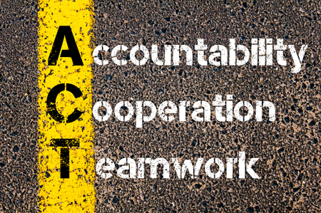 accountability: Concept image of Business Acronym ACT Accountability, Cooperation, and Teamwork written over road marking yellow paint line. Stock Photo