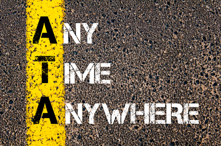 ata: Concept image of Business Acronym ATA Any Time Anywhere written over road marking yellow paint line