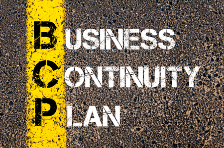 bcp: Concept image of Business Acronym BCP Business Continuity Plan written over road marking yellow paint line