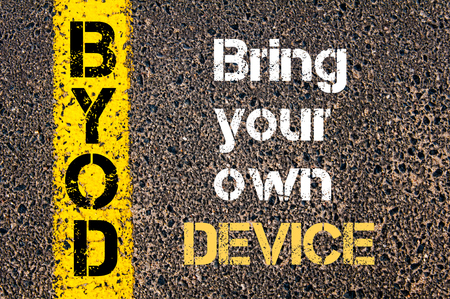 bring: Concept image of Business Acronym BYOD Bring your own device written over road marking yellow paint line