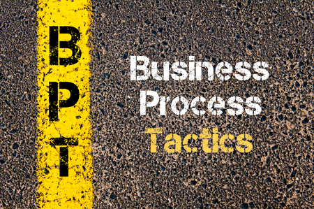 road marking: Concept image of Business Acronym BPT Business Process Tactics written over road marking yellow paint line