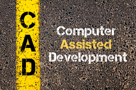 cad: Concept image of Business Acronym CAD Computer Assisted Development written over road marking yellow paint line Stock Photo