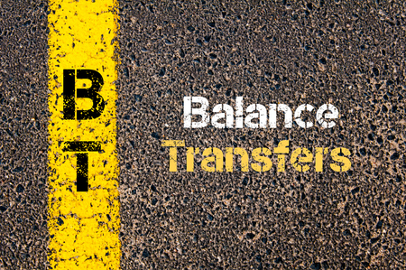 transfers: Concept image of Business Acronym BT Balance Transfers written over road marking yellow paint line Stock Photo