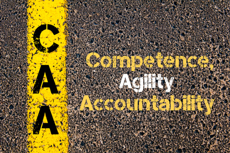accountability: Concept image of Business Acronym CAA Competence, Agility, Accountability written over road marking yellow paint line Stock Photo